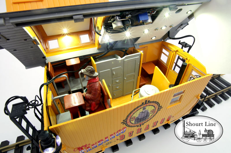 LGB 47656 Fandango in Durango 8-wheel Bobber Caboose + SL 8134230 13 LED High Efficiency dual ceiling fixtures and 2 coach LEDs + SL 8453303 Precision Train Throttle & LED controller + SL 6011604 Extreme low drag power pick-up for LGB two axle trucks + 2 each PIKO 36161 Metal Wheel sets + 10,000uF buffer anti-flicker capacitor Interior view roof lifted up